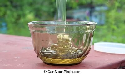 Honey pouring into bowl