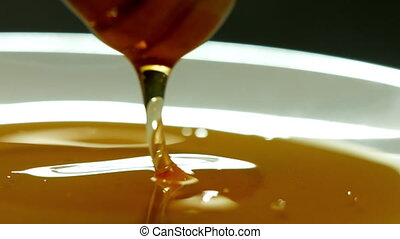 Honey pouring slow motion