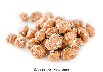 Honey roasted coated peanuts and white sesame seeds.