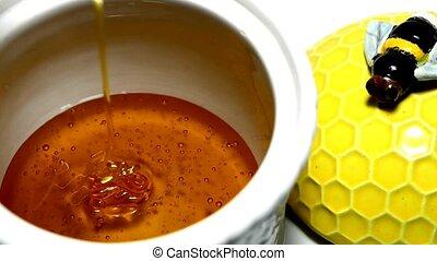 Honey running into a pot