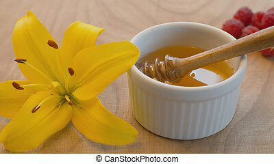 Honey spoon in a bowl with honey