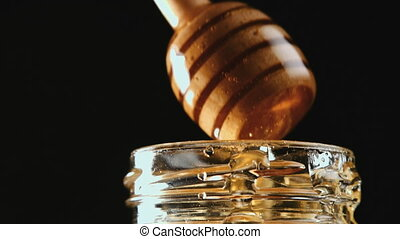Honey stick getting out of jar