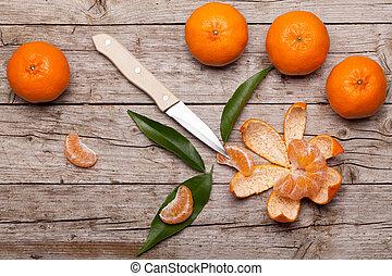 Honey Tangerines On Wood Table