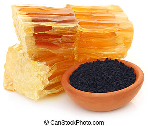 Honey with black cumin in a pottery