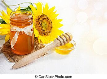 Honey with sunflower. Honey Background.