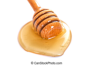 Honey with wooden dipper isolated on white background