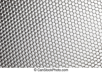 black, metal honeycomb grid on white abstract background