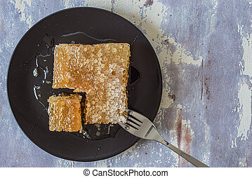 Honeycomb on black plate on grey background