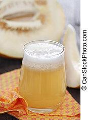 Honeydew melon juice - Honeydew melon fresh juice on wooden...