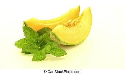 Honeydew melon - Juicy honeydew melon on a white background.