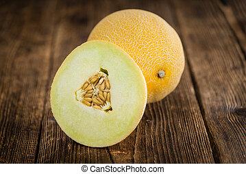Fresh made Honeydew Melon on a vintage background (close-up shot)