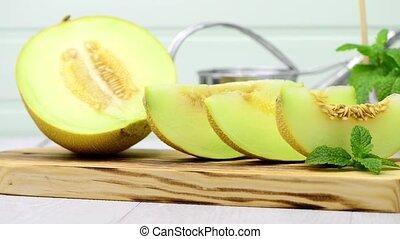 Honeydew melon - Juicy honeydew melon on a wooden table...