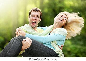 Honeymoon - Happy couple outdoors
