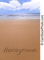 Honeymoon on the beach. - Honeymoon written in sand on the...