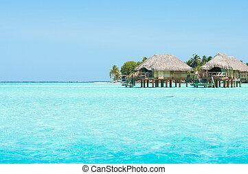 Honeymoon paradise - Horizontal shot of overwater bungalows...