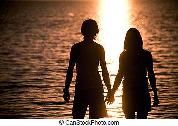 Honeymoon - Profiles of romantic couple holding each other...
