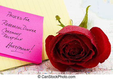 Honeymoon - Red rose on map with note about wedding and...