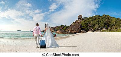 honeymoon - happy newly married couple in honeymoon, on sun...