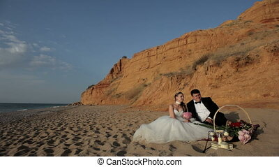 Honeymoon - The newlyweds had a picnic on the beach.