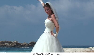 Bride in Wedding Dress over Blue Sky