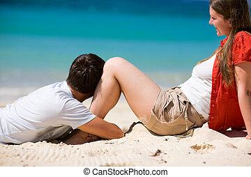 Honeymooners - Young happy couple on white sand beach