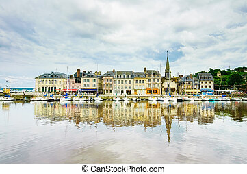 Honfleur famous village skyline and harbor with reflection. Normandy, France, Europe.