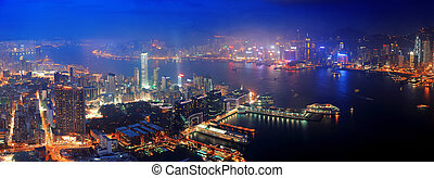 Hong Kong aerial night - Victoria Harbor aerial view with ...