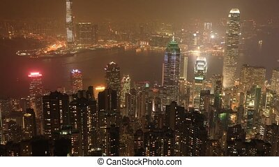 Hong Kong by night - Aerial view of Hong Kong at night with...