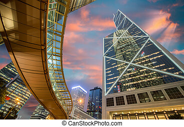 Hong Kong by night. Pedestrian passage over street level and...