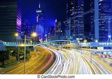 Hong Kong city at night with light trails