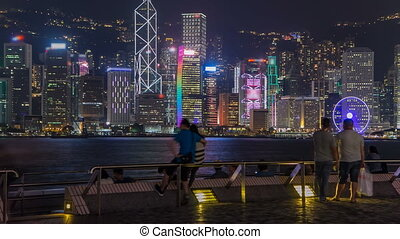 Hong Kong city skyline at night over Victoria Harbor with ...