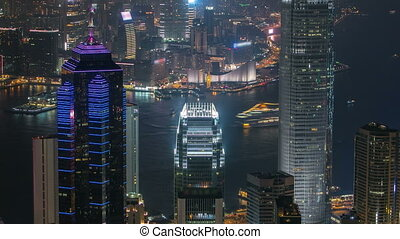 Hong Kong city skyline timelapse at night with Victoria...