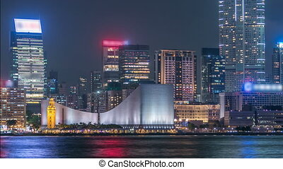 Hong Kong Cultural Centre with colorful light projection on...