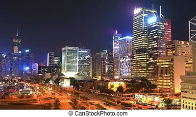 Spectacular aerial view of cityscape in Hong Kong, Central District, with city night traffic at Victoria Harbour illuminated. Wide view time lapse.