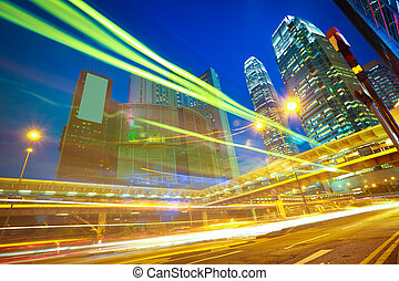 Hong Kong modern landmark buildings backgrounds of city road light trails
