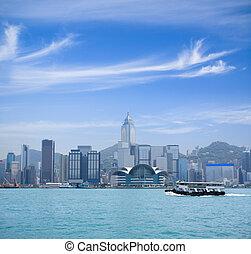 hong kong victoria harbor against a blue sky