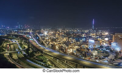 Hong Kong Skyline and Container Terminal at Night timelapse - Hong Kong Kwai Tsing Container Terminals is one of the busiest ports in the world.