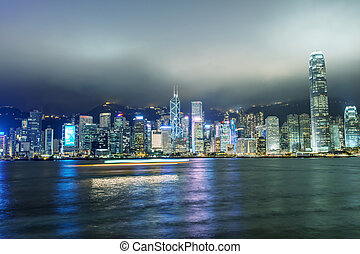 Hong Kong. Skyscrapers reflection with boat light trails