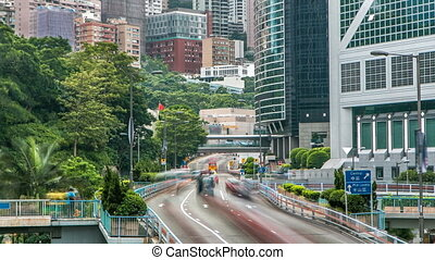 Hong Kong traffic timelapse near bank tower in Central District of Hong Kong.