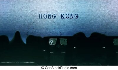 Hong Kong words Typing on a sheet of paper with an old vintage typewriter.