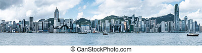 Hong Kong's Victoria Harbour, the tall buildings of the...