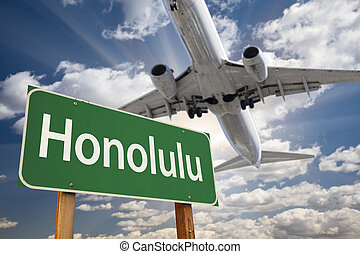 Honolulu Green Road Sign and Airplane Above with Dramatic Blue Sky and Clouds.