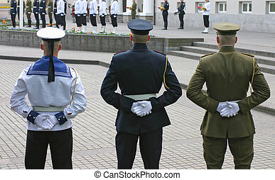 Honor guard - Three soldiers stand guard at lithuanian...