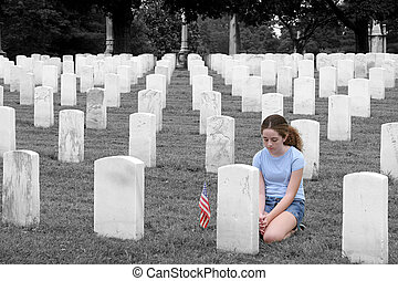 Honoring The Fallen SC - a young girl in a military cemetary...