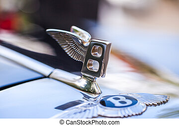 hood ornament letter b with wings on a Bentley