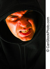 Hooded anger - Angry hooded male looking at you with a ...