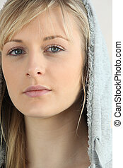 Hooded blonde woman