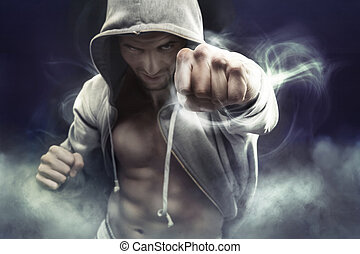 Hooded boxer punching an enemy - Hooded muscular boxer...
