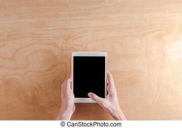 hoogste mening, van, mannetje hands, holdind, tablet, beroeren, computer, gadget, op, houten, achtergrond.