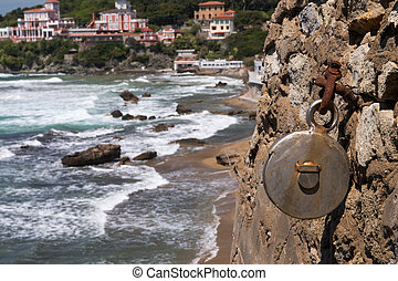 Hook in the rock with sea on background
